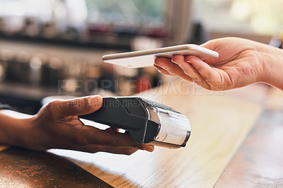 Buy stock photo Shot of a customer paying with her cellphone using nfc technology