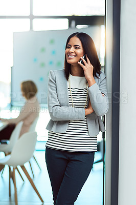 Buy stock photo Cropped shot of a beautiful young businesswoman on a call in the workplace