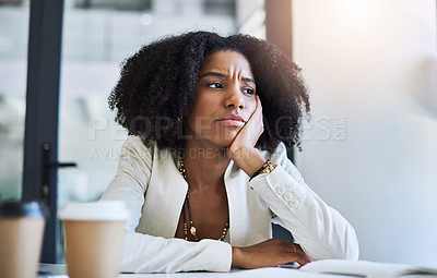 Buy stock photo Shot of a young businesswoman looking stressed and frustrated at her office desk
