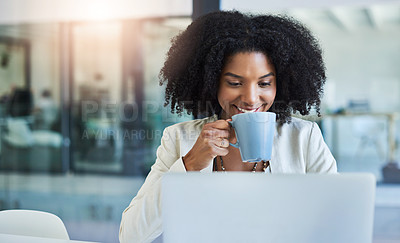 Buy stock photo Shot of a young businesswoman having a cup of coffee while doing some work at her office desk