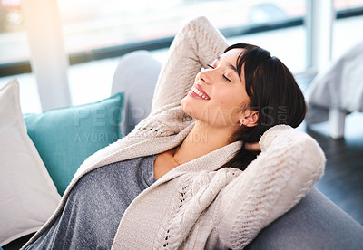 Buy stock photo Shot of a relaxed young woman lying back on a sofa trying to take nap at home during the day