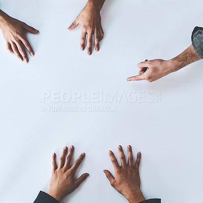 Buy stock photo Studio shot of a group of unrecognisable people having a meeting against a white background