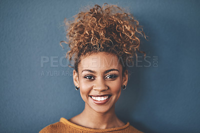 Buy stock photo Studio portrait of an attractive young woman standing against a grey background