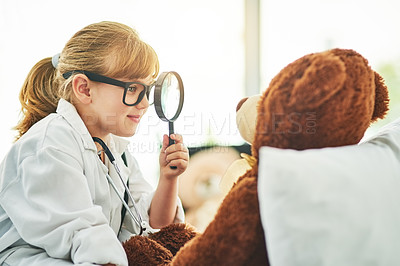 Buy stock photo Shot of a little girl pretending to be a doctor