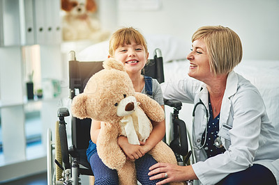 Buy stock photo Shot of an adorable little girl in a wheelchair going for a checkup at the doctor