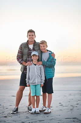 Buy stock photo Portrait of a father having fun with his young sons at the beach