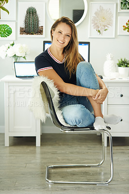 Buy stock photo Portrait of a confident young woman working in a home office