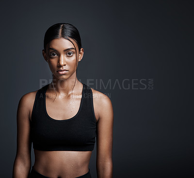 Buy stock photo Studio portrait of a young sportswoman posing against a gray background