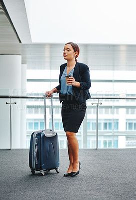 Buy stock photo Full length shot of an attractive young businesswoman standing with her luggage in the airport