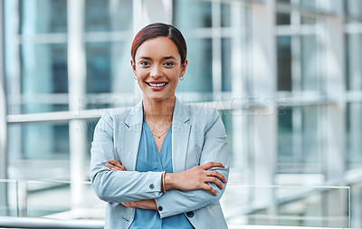 Buy stock photo Cropped portrait of an attractive young businesswoman standing with her arms folded in the airport