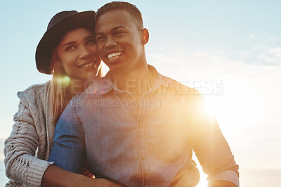 Buy stock photo Shot of a happy young couple enjoying a romantic day outdoors