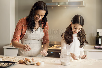 Buy stock photo Shot of a young girl and her mother having fun while baking at home