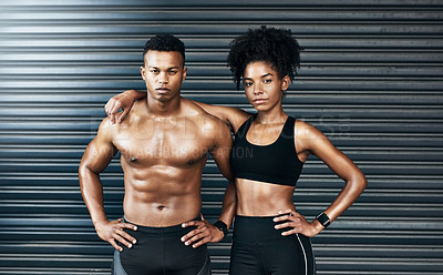 Buy stock photo Portrait of a sporty young couple standing together against a grey background