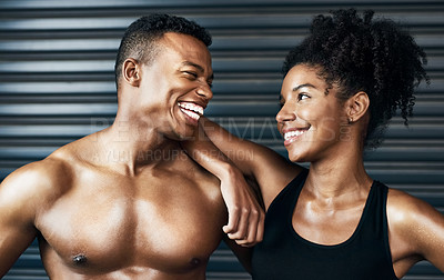 Buy stock photo Shot of a sporty young couple standing together against a grey background