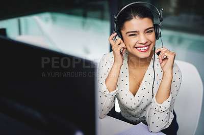 Buy stock photo Cropped portrait of an attractive young businesswoman working late in a call center