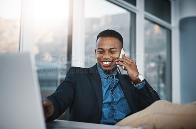 Buy stock photo Cropped shot of a handsome young businessman making a phonecall while working in his coffee