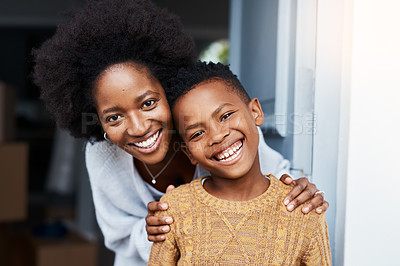 Buy stock photo Portrait of a mother and her little son standing at the front door of their house