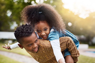 Buy stock photo Shot of two adorable little siblings playing together outdoors