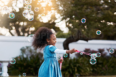 Buy stock photo Cropped shot of an adorable little girl playing in the yard