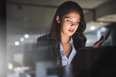 Buy stock photo Cropped shot of an attractive young businesswoman getting frustrated while working on her laptop late in the office