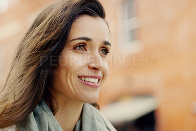 Buy stock photo Closeup shot of an attractive young woman smiling and posing in the city