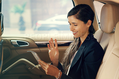 Buy stock photo Shot of an attractive young businesswoman sitting inside a car and sending text messages while traveling to work