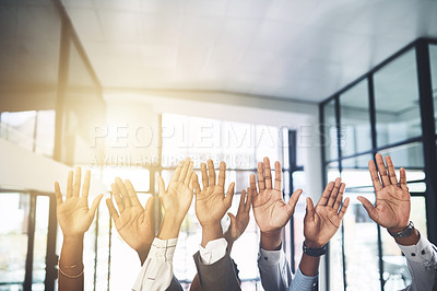 Buy stock photo Closeup shot of a group of businesspeople raising their hands in an office