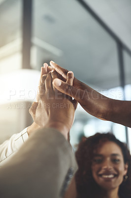 Buy stock photo Closeup shot of a group of businesspeople giving each other a high five in an office