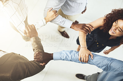 Buy stock photo Closeup shot of a group of businesspeople linking their arms in solidarity