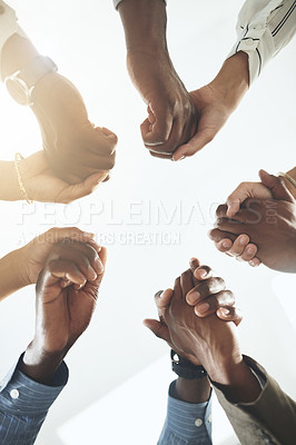 Buy stock photo Closeup shot of a group of businesspeople holding hands