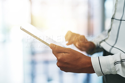 Buy stock photo Closeup shot of an unrecognizable businesswoman using a digital tablet in an office