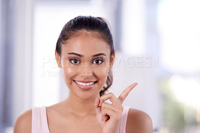 Buy stock photo Portrait of an attractive young woman gesturing while going through her morning beauty routine at home