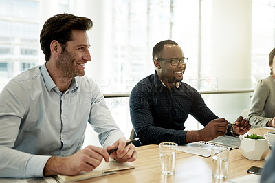 Buy stock photo Cropped shot of businesspeople sitting a table in the boardroom during a meeting