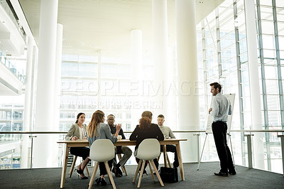 Buy stock photo Full length shot of a handsome mature businessman giving a presentation in the boardroom