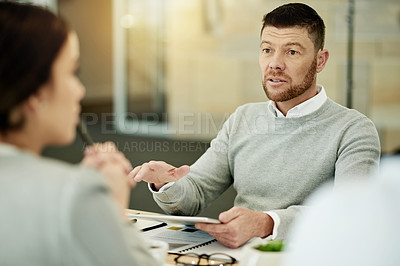 Buy stock photo Cropped shot of a handsome mature businessman siting in the boardroom during a meeting