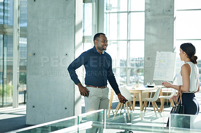 Buy stock photo Cropped shot of businesspeople having a conversation in the workplace