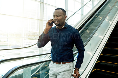 Buy stock photo Cropped shot of a businessman on a call in the workplace