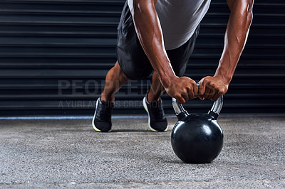 Buy stock photo Cropped shot of an unrecognizable man working out with weight