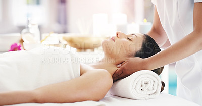 Buy stock photo Cropped shot of an attractive young woman lying on a massage table
