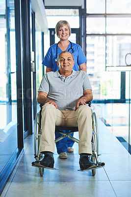 Buy stock photo Shot of a female nurse seeing a patient in a wheelchair