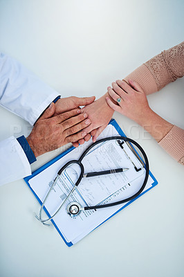 Buy stock photo Closeup shot of a doctor holding a patient's hand in comfort