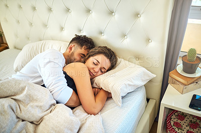 Buy stock photo Cropped shot of an affectionate young couple sleeping in their bed