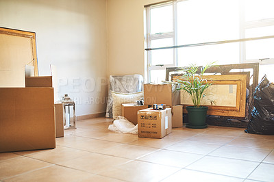 Buy stock photo Shot of boxes packed and stacked in a living room on moving day