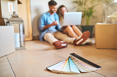 Buy stock photo Shot of color swatches lying on the floor of the new home of a young couple