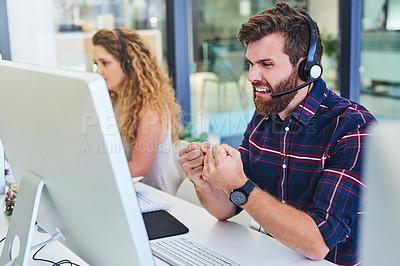 Buy stock photo Shot of a young man looking angry in a call centre