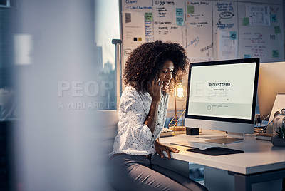 Buy stock photo Cropped shot of an attractive young creative businesswoman making a phonecall while working in her office