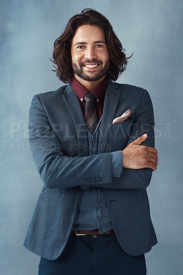 Buy stock photo Studio shot of a handsome and dapper young man posing against a grey background