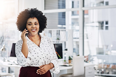 Buy stock photo Portrait of a young businesswoman using a smartphone in a modern office