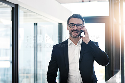 Buy stock photo Portrait of a mature businessman using a smartphone in a modern office