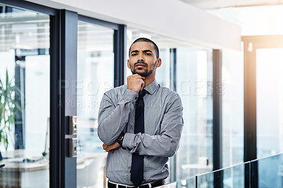 Buy stock photo Portrait of a young businessman looking unsure in a modern office